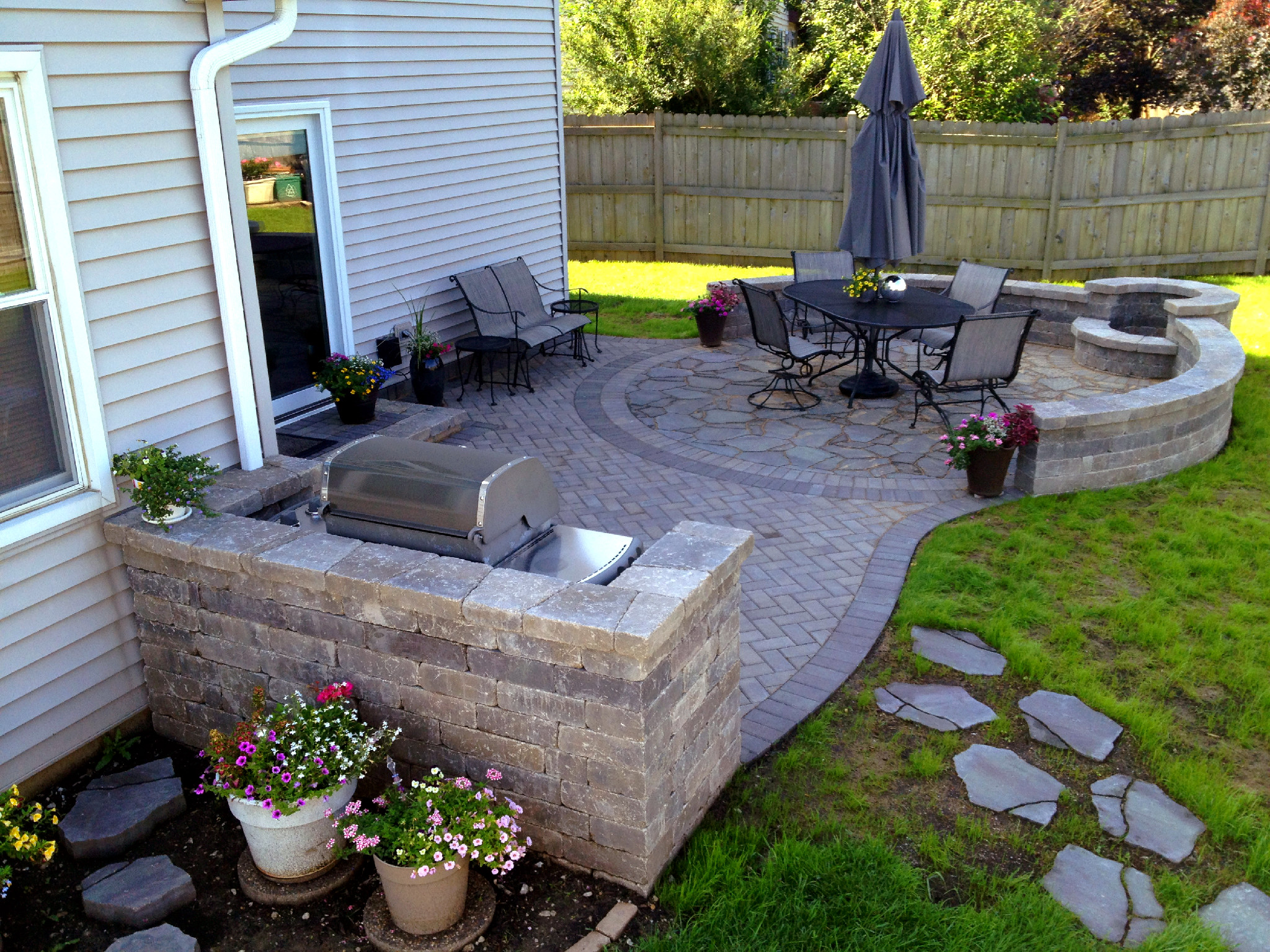 Should i use concrete or pavers for my chicagoland patio for Different patio designs