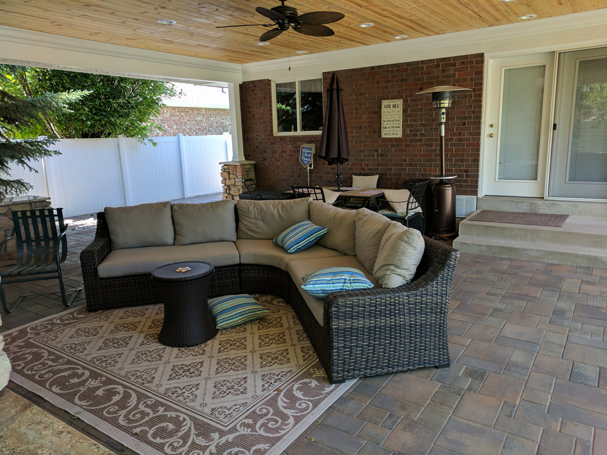 ogden covered patio with fireplace and tv makes backyard