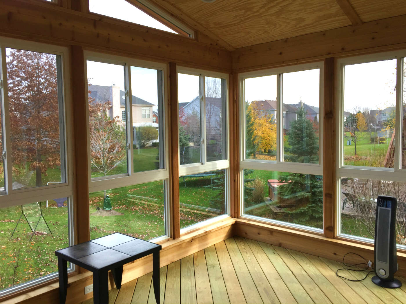 How can i enjoy my outdoor living space in the colder for Cedar sunroom
