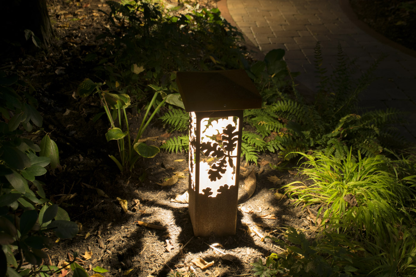 A Decorative Outdoor Lighting Fixture Anchors This Cleveland Landscape