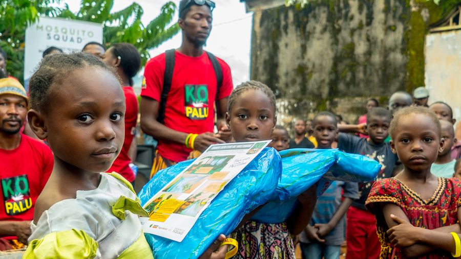 Cameroon children receiving life saving mosquito nets