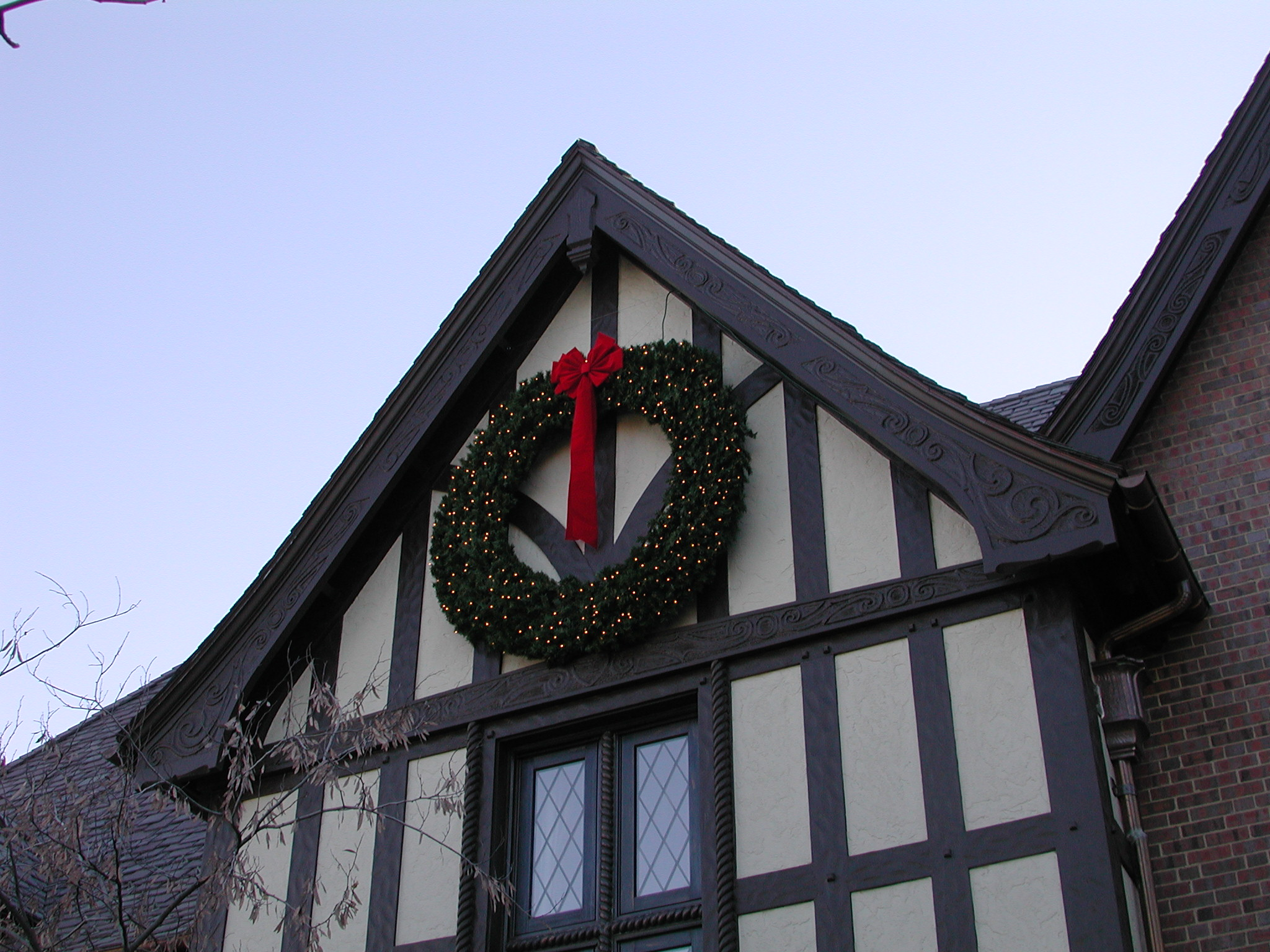 Large lighted wreath at Denver Country Club home. Outdoor Lighting Perspectives holiday lighting designs include wreaths of all sizes. At this home, we installed an eight-foot diameter lighted wreath.