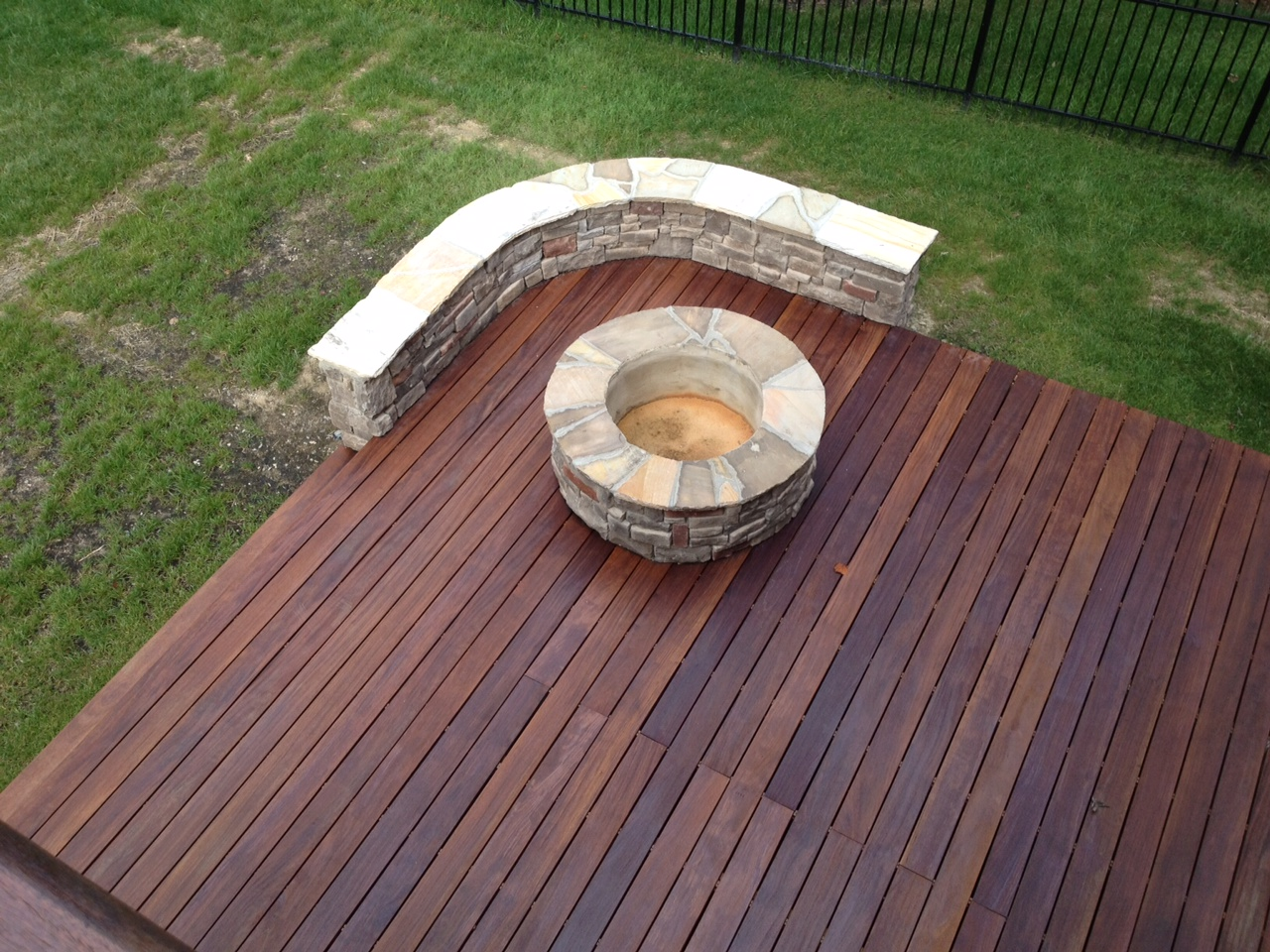 Metal fire pit on wood deck - With Many Options In Pavers And Stone An Outdoor Firepit Is A Natural Addition For Your Patio With Custom Options For Accessories Such As Wood