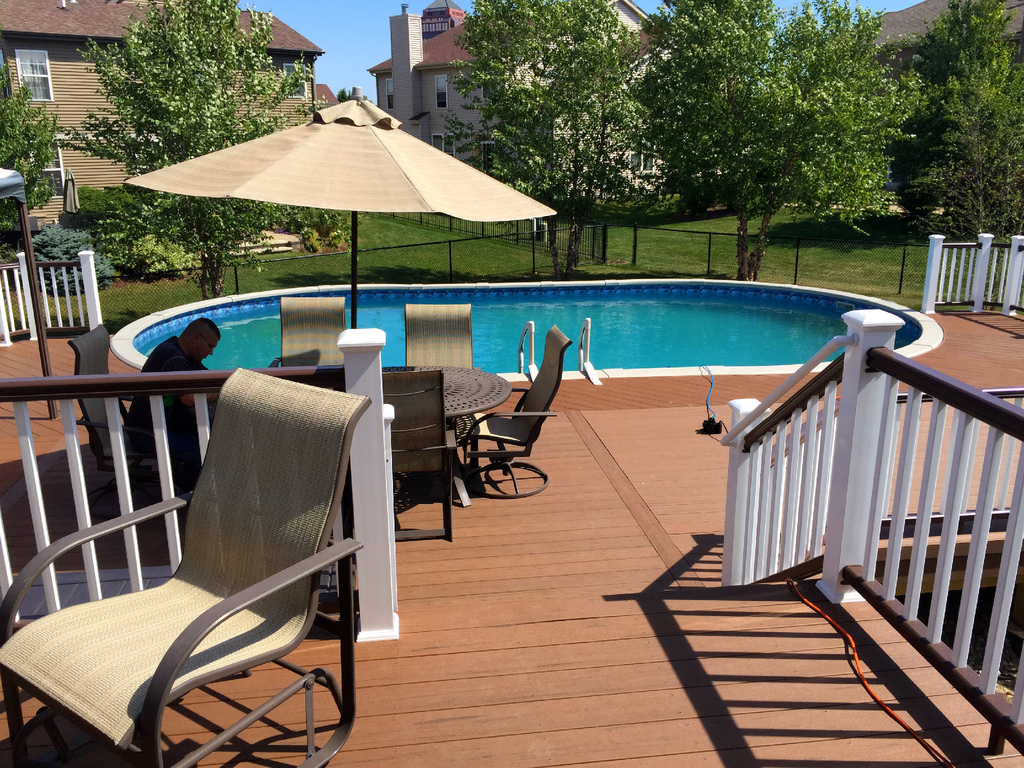 How much does a chicagoland pool deck cost archadeck for Deck from house to above ground pool