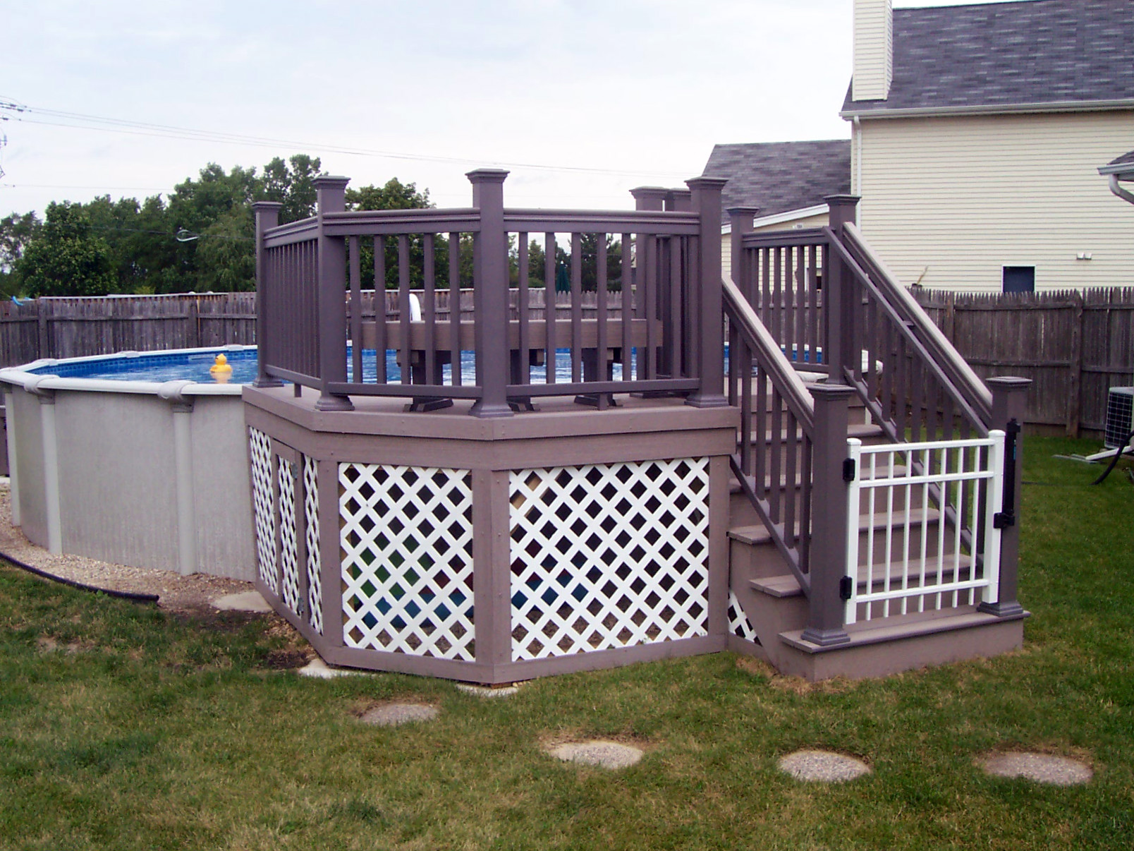 How much does a chicagoland pool deck cost archadeck for Above ground pool with decks