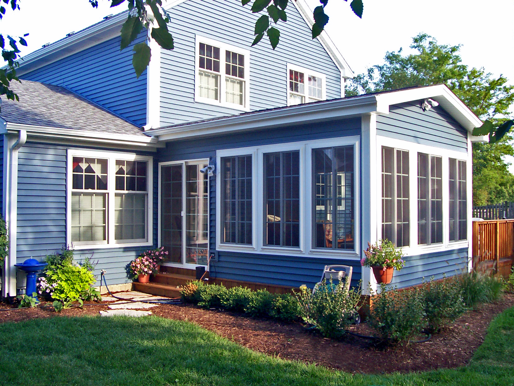 Pics of sunrooms gallery of three season sunrooms with for Porch sunroom