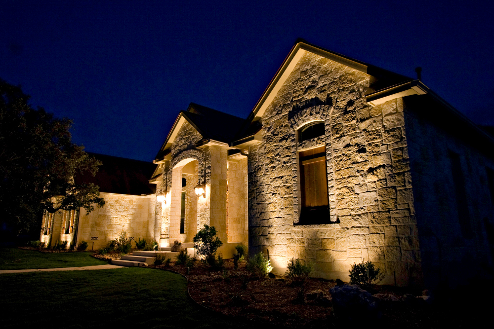 St. Louis architectural lighting stone house. It might seem counter-intuitive that textural details such as a home's stone facade could be seen at night with outdoor lighting. Look at how well this stone facade can be seen at night.