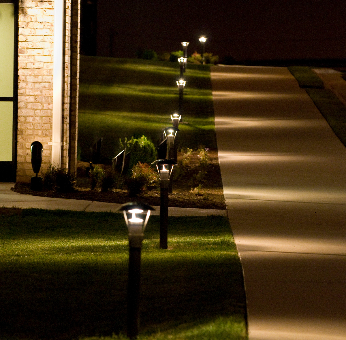Who knew the path that leads to work could be so beautiful? We used Bollard lights to light this long stretch of path in this commercial environment. They illuminate the path for added safety without overpowering it. The sleek design adds a touch of elegance to an otherwise boring space as well.