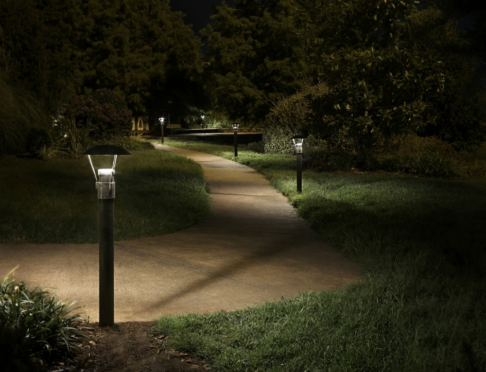 A well lit path is a safer path. Park settings, such as this meandering path benefit from commercial outdoor lighting. This St. Louis park is safer, and more beautiful with the addition of bollard path lighting.