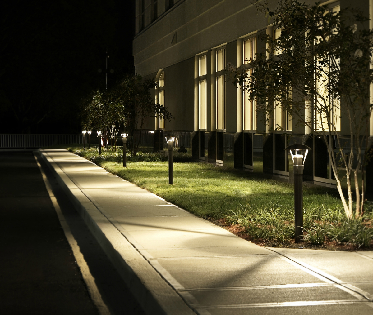Commercial path lighting in St. Louis makes the walk to your office pleasant. We used bollard lights to illuminate this sidewalk and the area around the sidewalk on this commercial venue. Commercial lighting of this quality adds beauty to your commercial building and makes the property more safe and secure for employees and customers.