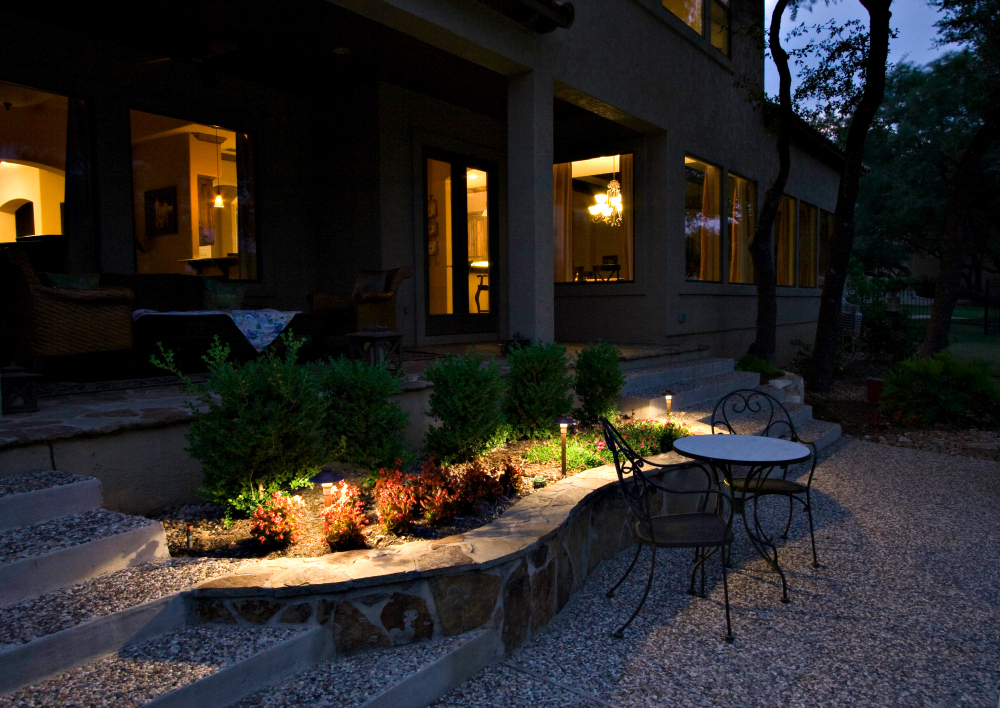 Outdoor patio lighting St. Louis. Look at the way this patio is illuminated to create a soft romantic setting to enjoy this outdoor area at night.