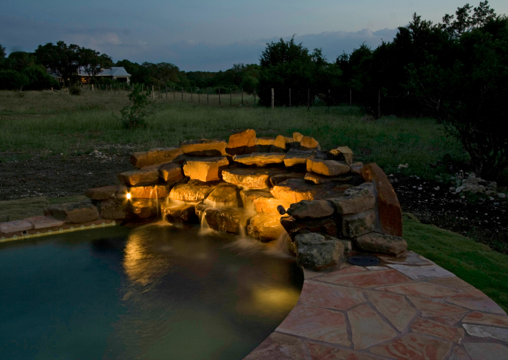 St. Louis water feature lighting. We've all seen the way water sparkles and glistens under the right light. Custom water features are more popular than ever partially because they can be illuminated to enjoy throughout the evening.