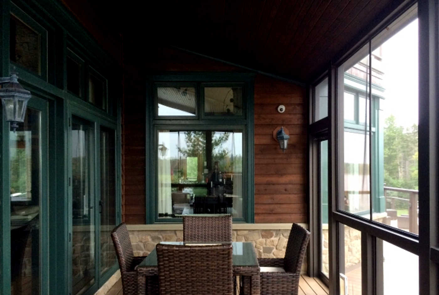 screen porch with cozy fireplace