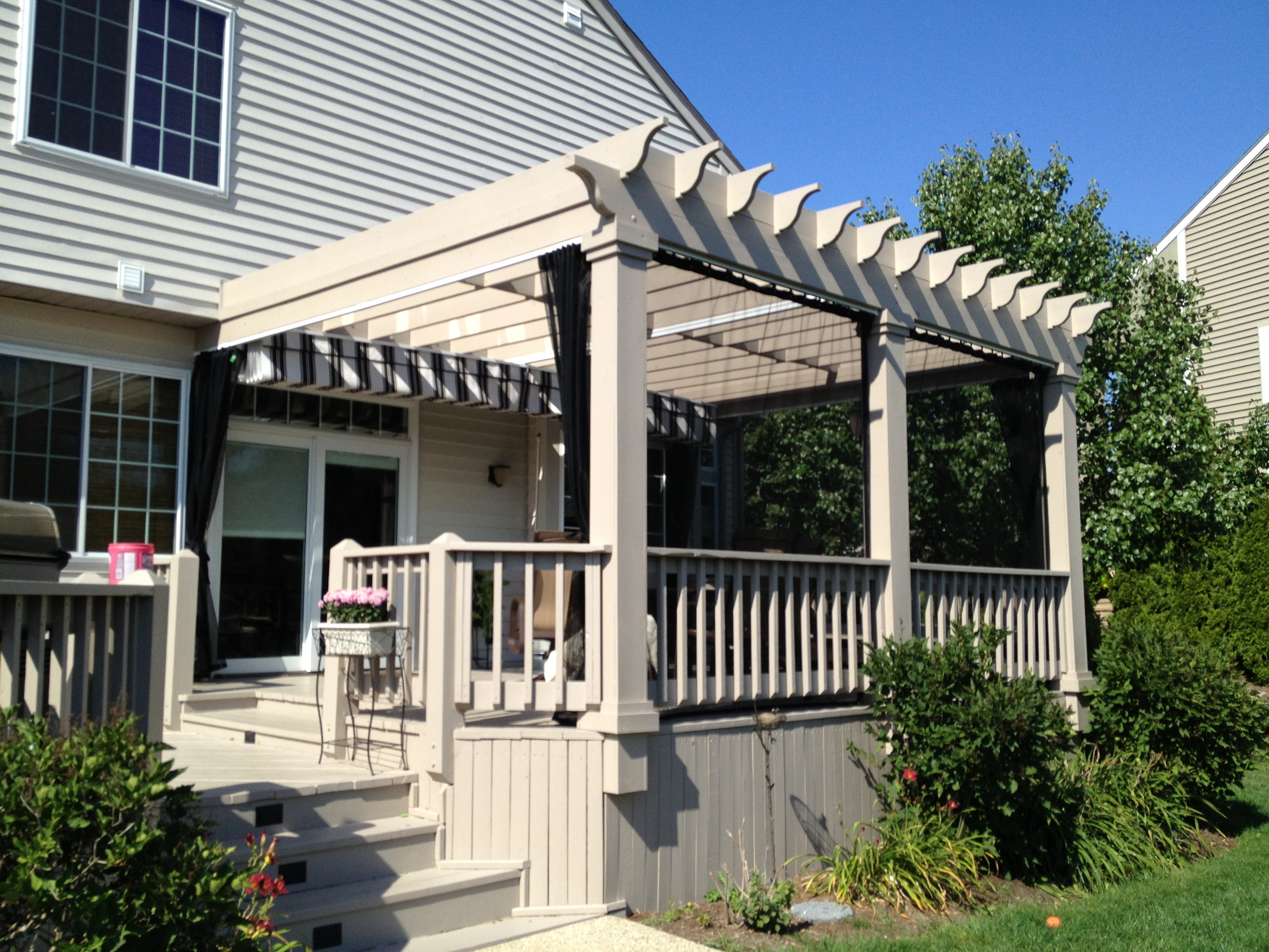 Pergola with Mosquito Curtains an Alternative to a Screened in