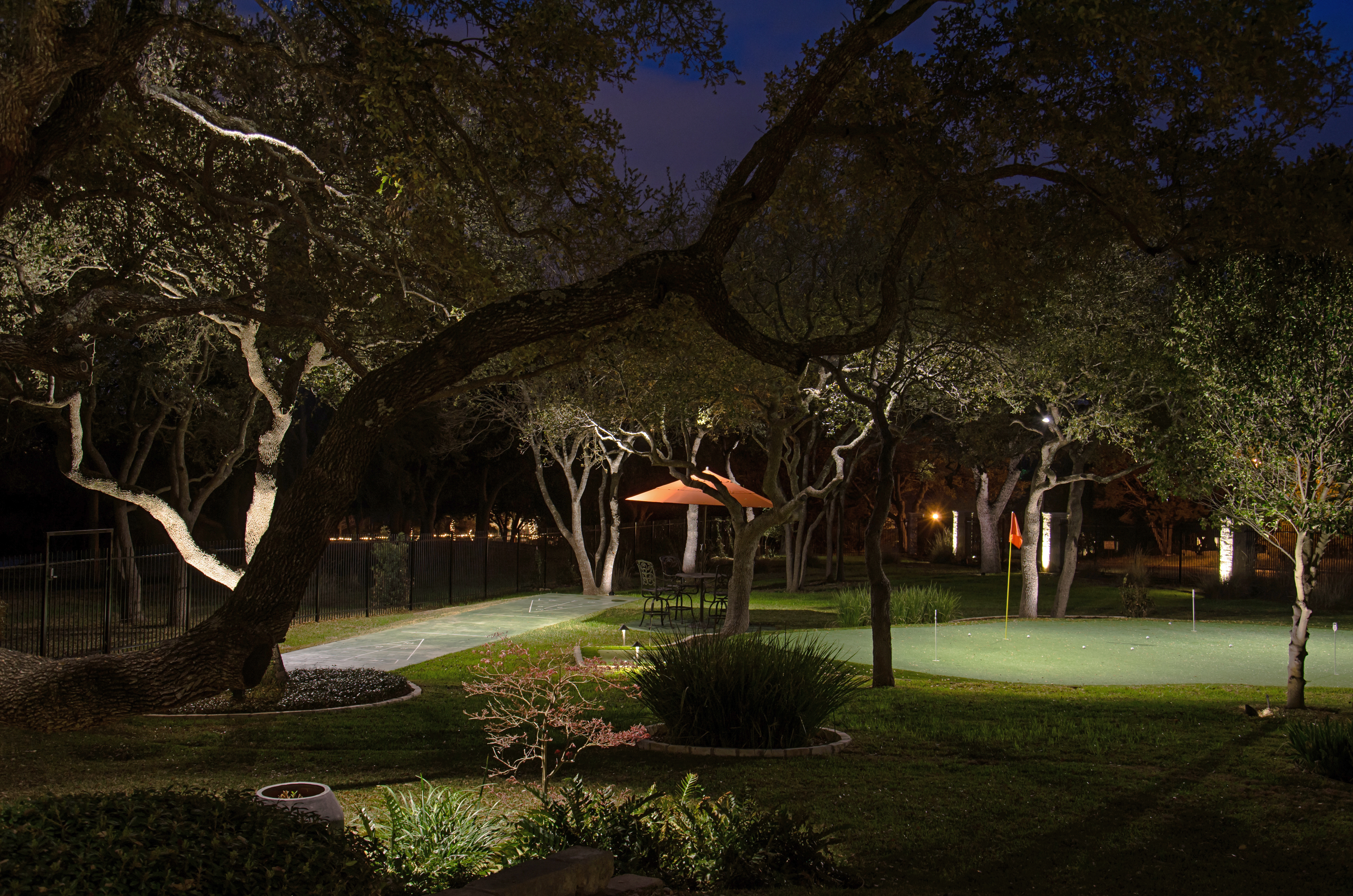 Landscape Lighting in Austin and the surrounding areas. By adding, outdoor lights to this backyard space, the homeowners can now enjoy their outdoor living areas