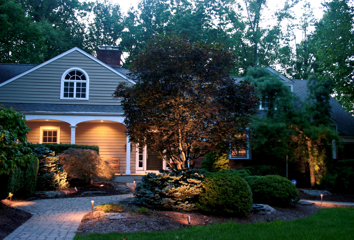 Architectural Lighting in Westfield, NJ. A relatively small number of quality outdoor lights, thoughtfully designed, provides dramatic results on this Union County, NJ home.