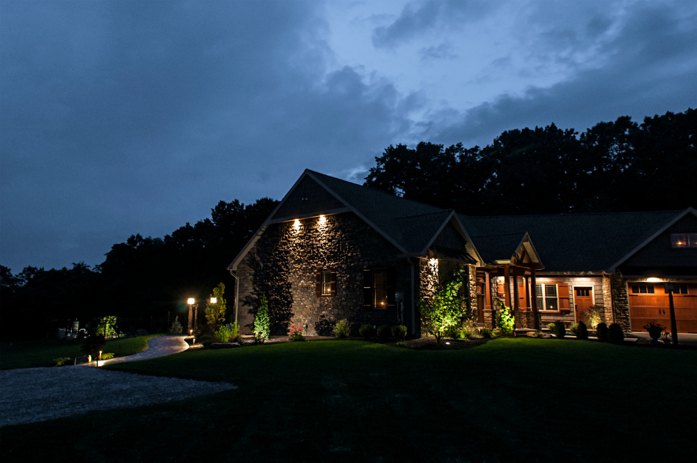 LED low voltage lights illuminate the beauty of Lancaster homes. This home built by Merv Miller Builders in Lancaster shines beautifully with Outdoor Lighting Perspectives LED lights.  These low voltage lights do not have the customary blue glow of LED, instead you can not tell the difference from halogen.