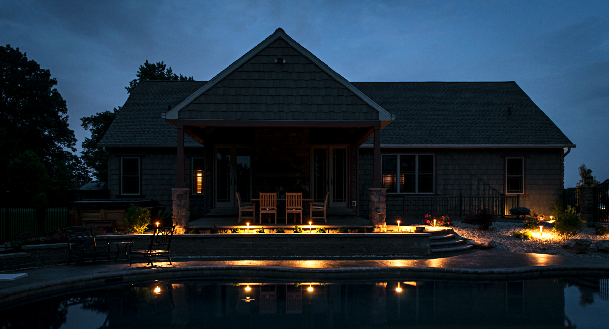 """Low voltage LED pool lighting. This Lancaster home with an Integrity pool and low voltage LED lighting by Outdoor Lighting Perspectives, Lancaster - West Chester enables the homeowner to be able to enjoy their pool or patio in the evening without being in the """"spotlight""""."""