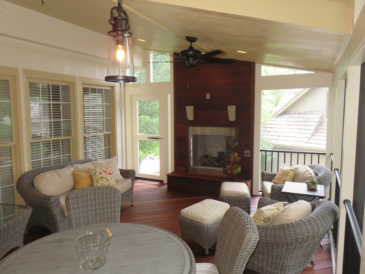 Screened Porch With Shed Roof, Open Gable, And Outdoor Fireplace