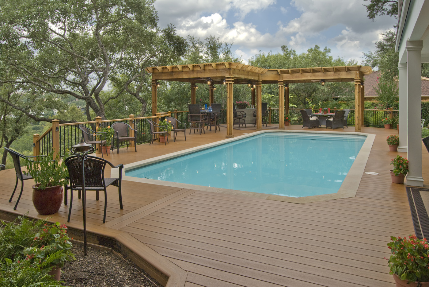 Low maintenance synthetic decking options for care free for Wood pool deck design