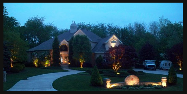 Landscape Lighting enhances this yard and highlights signage