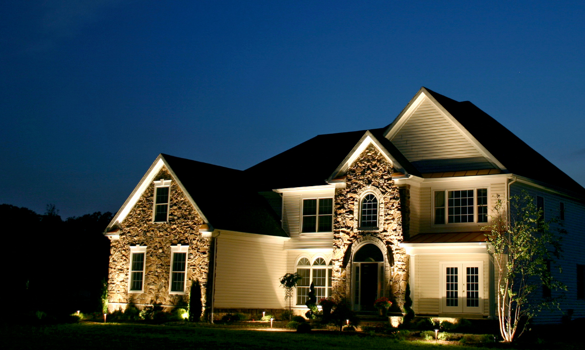 Outdoor lighting in Rye illuminates this home after dark. The architectural and textural details of the home can now be appreciated at all times of the day with addition of uplighting and landscape lighting.