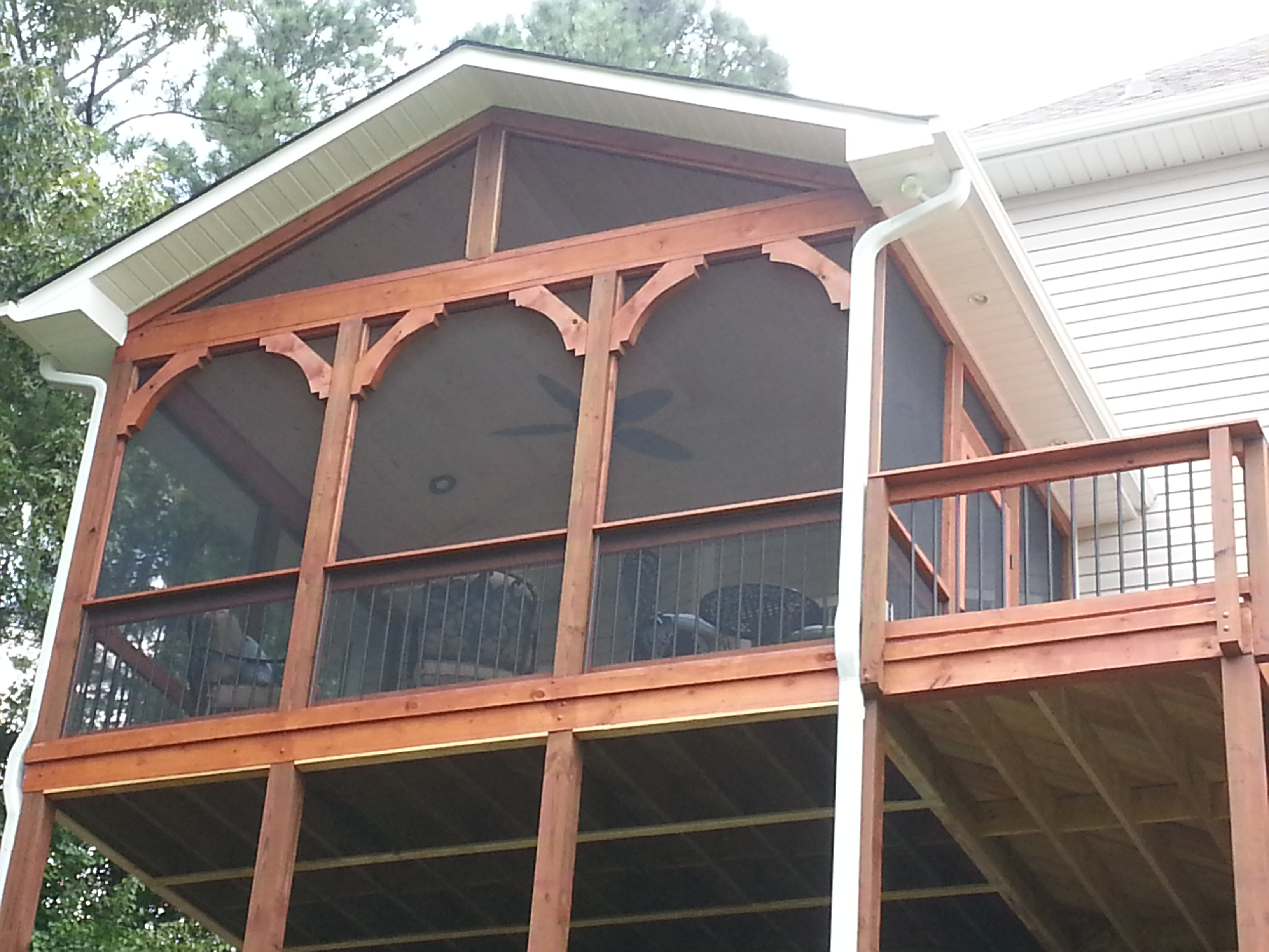 anderson builder custom porch five flooring post with builders pictures rails and hip roofed sided in screen cedar projects fredericksburg breeze wall into ez winds eagle northern t doors mahogany decks com deckworks by g va screened deck leading