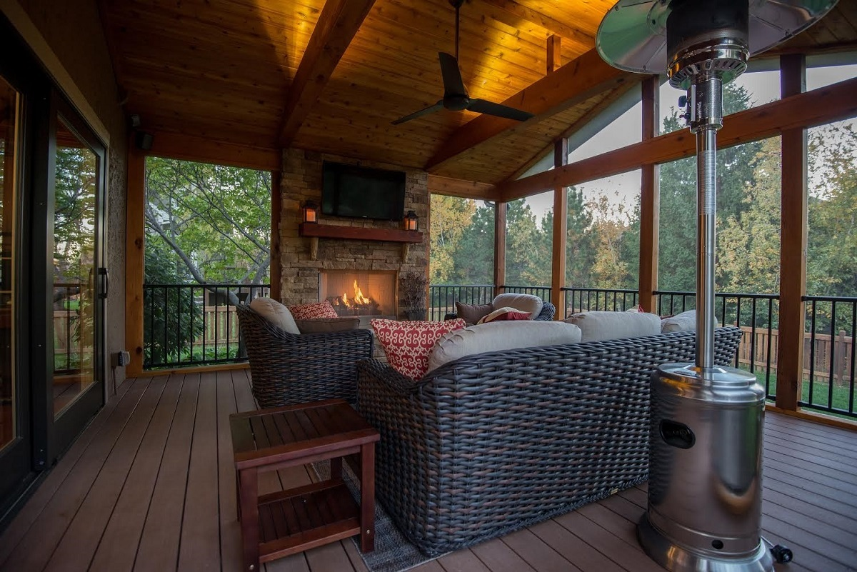 Autumn-ready-screened-porch-with-fireplace-and-integrated-wall-mounted-TV