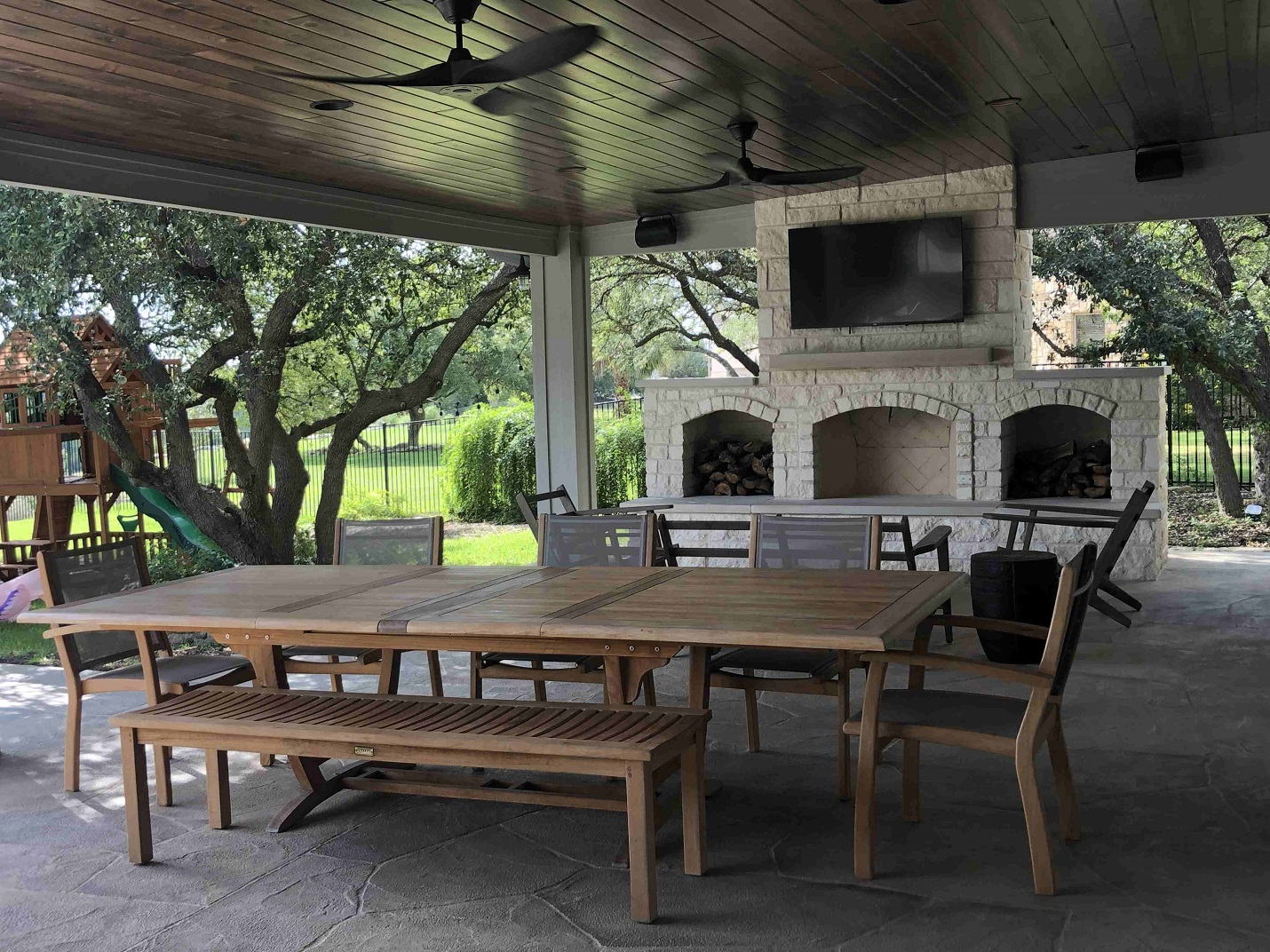 Custom-patio-cover-with-outdoor-fireplace-and-kitchen