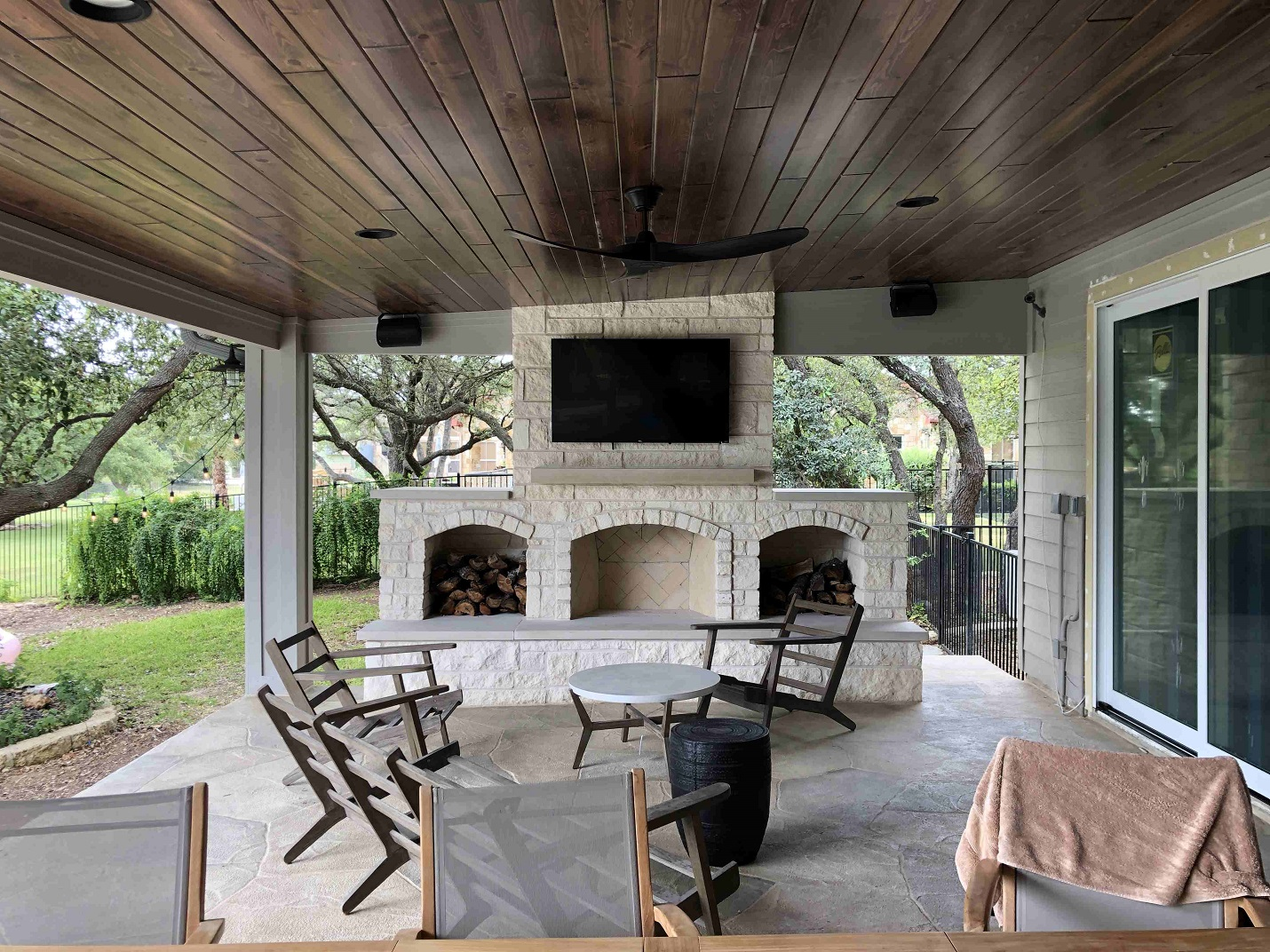 Look-at-this-beautiful-outdoor-fireplace-that-is-now-part-of-the-covered-patio