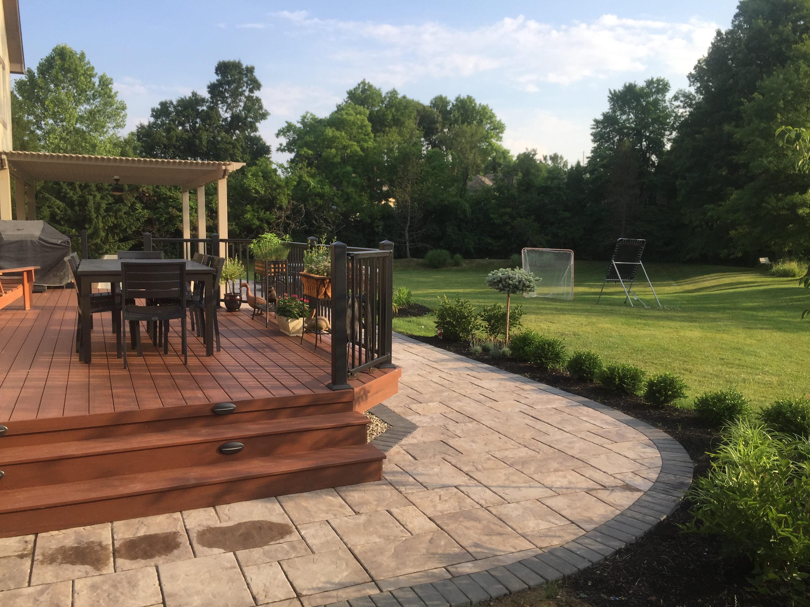 This Custom Outdoor Living Combination Space In New Albany Includes A  Spacious Deck And Patio, Outdoor Fire Feature, Pergola And Retaining Wall.