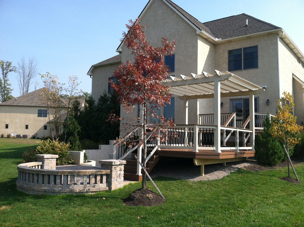 In The Photo Above, Youu0027ll Not Only See A Beautiful Composite Deck, But  Also A Paver Patio And Stately Pergola. The Deck Is Made Of TimberTech ...