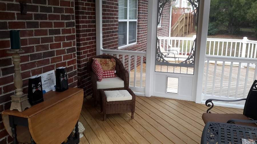 This-Columbia-screened-porch-has-a-pet-door-making-the-deck-accessible-for-the-homeowner's-beloved-cats