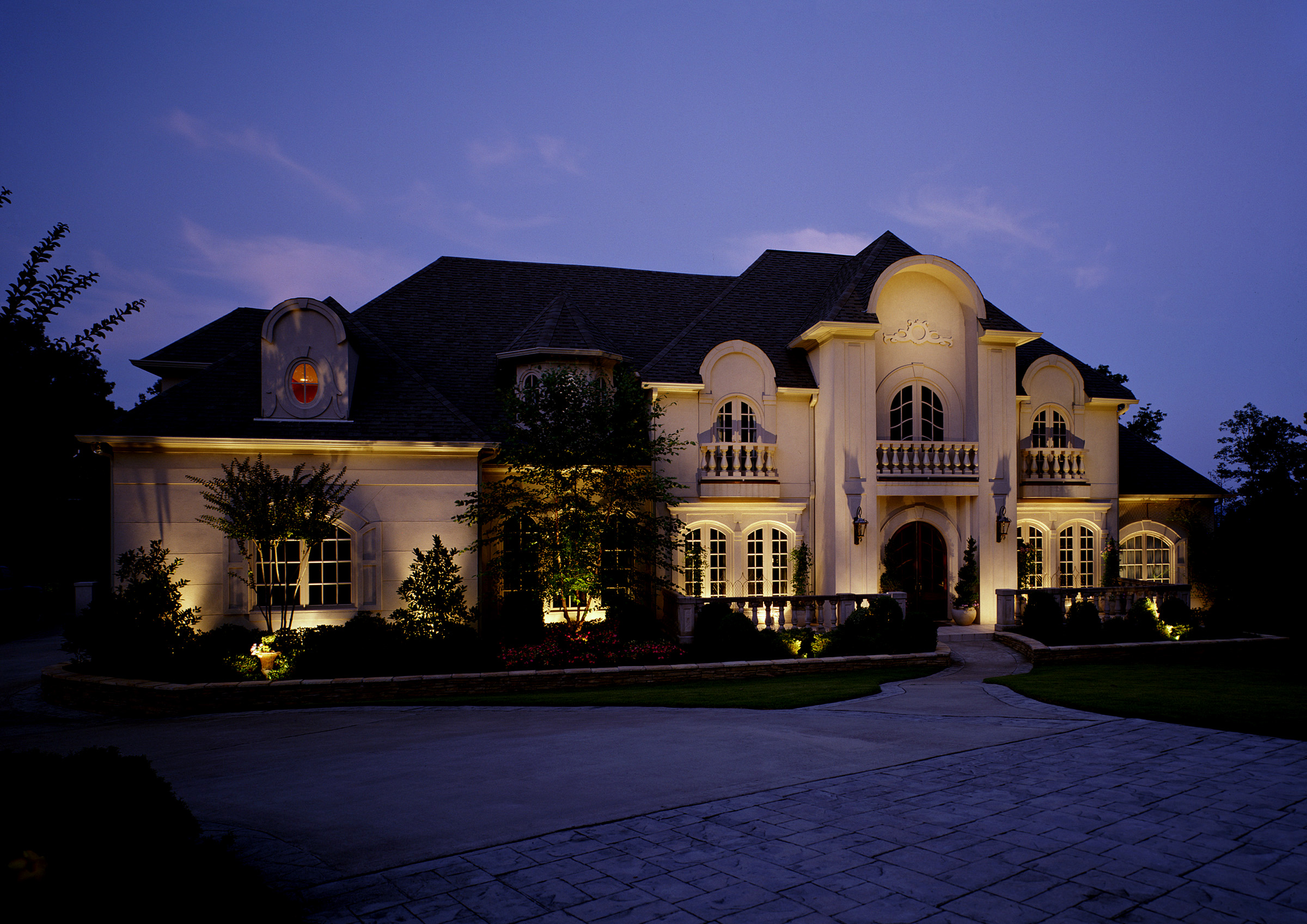 Outdoor Lighting Creates Class and Elegance. This Mountain Brook, AL home comes to life at night with tasteful architectural lighting. The numerous features are accented with strategically placed well lights.