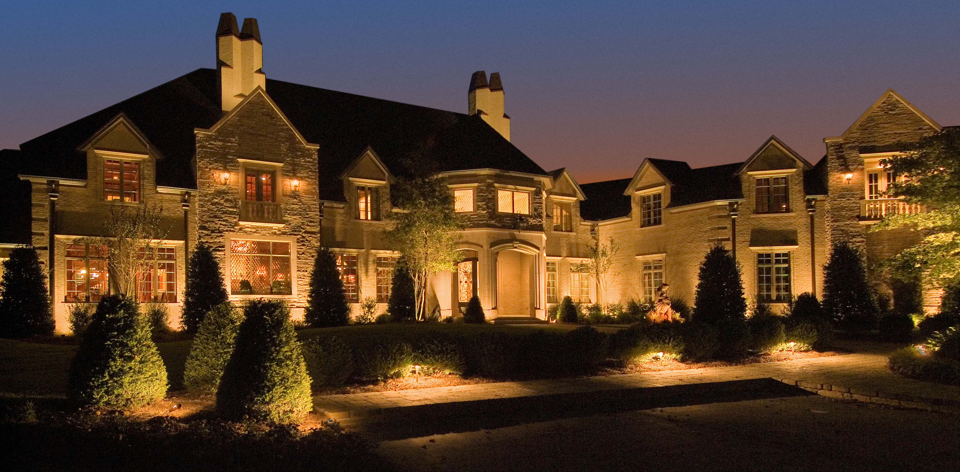 Architectural Lighting at its Finest. This stone mansion located in the suburbs of Birmingham, AL provided every imaginable architectural feature. The stone facade, the stately chimneys, and the entrance provided countless opportunities for accent lighting.