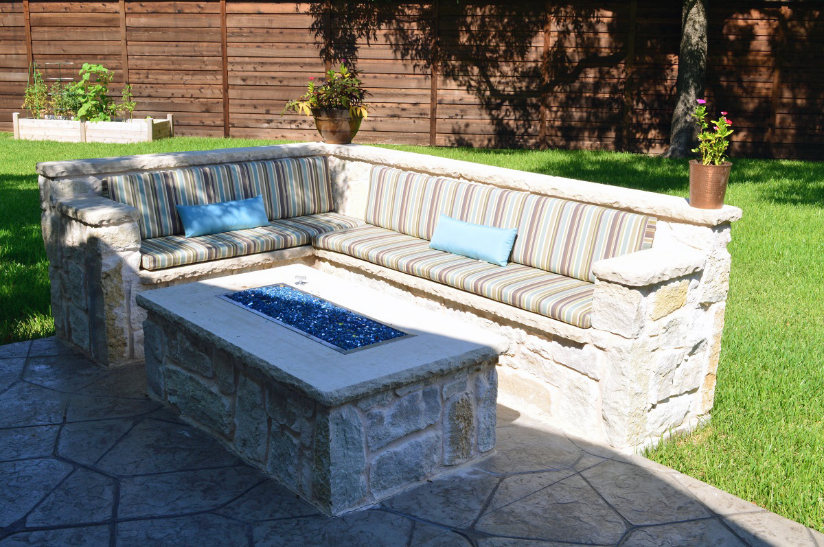 Stunning-custom-fire-pit-with-L-shaped-seating-wall