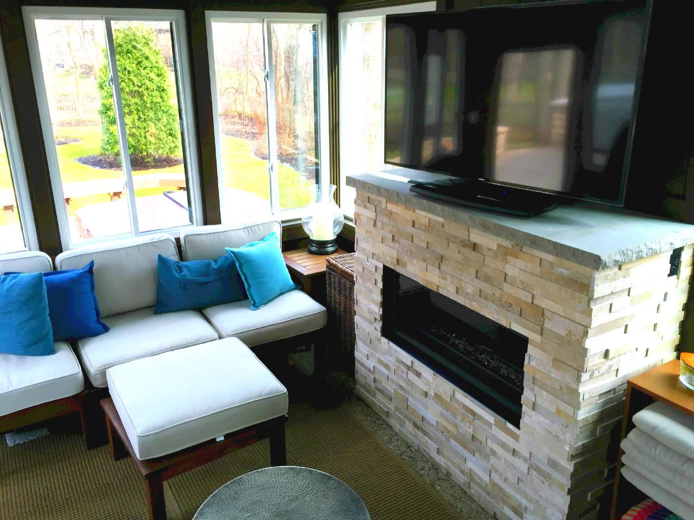 sunroom with fireplace. One of the most common requests we receive when area homeowners call for a  sunroom is to have loads windows and as much natural light possible Chicagoland sunrooms 3 season rooms 4 sun porches