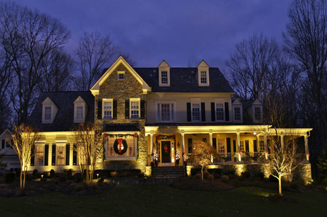 this home has traditional outdoor lighting for year round enjoyment along with some decorative christmas accents