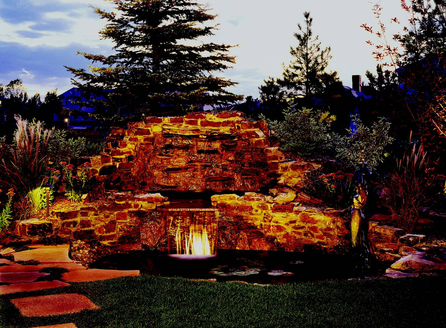 Buell Mansion/Cherry Hills Village backyard oasis. The only thing better than a relaxing water feature in the daytime, is a beautifully- illuminated water feature after dark. These homeowners wanted to be able to enjoy this focal point of their back yard 365 days a year.