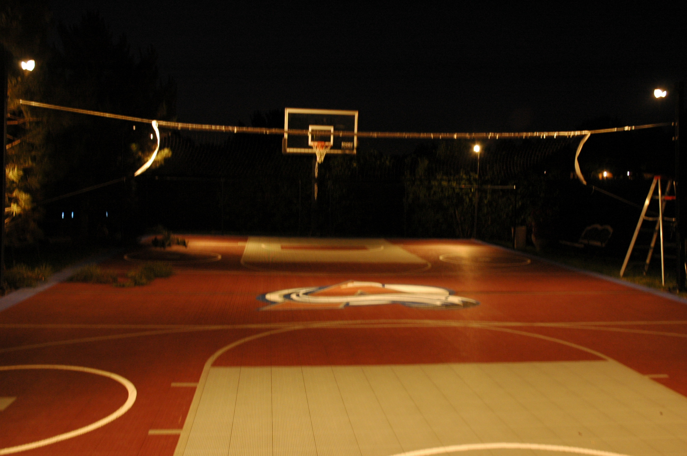 Sport Game Court Low Voltage Lighting - Greenwood Village. Colorado residents are very active, so it is inevitable that a significant portion of their gardens and landscaping may in fact be dedicated to sports activities. In many communities along the Colorado front range (Greenwood Village, Cherry Hills Village), line voltage lighting cannot be used to illuminate sport-game courts. However, low voltage lighting is permissible as long as the lighting is turned off when the court is not being used. At this sport-game court in Greenwood Village, a total of six of Outdoor Lighting Perspectives' copper (painted black) BB-01, 35W quartz halogen lighting fixtures were used to effectively illuminate the court for nighttime competition.