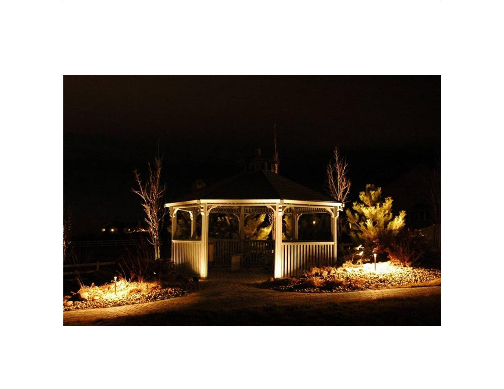 Todd Creek Farms - Brighton, CO gazebo lighting. Gazebos provide wonderful outdoor living spaces that are transformed after dark with accent lighting. At this site in Todd Creek Farms, the site for the gazebo was made level with a terraced rock wall and it is illuminated by a series of Outdoor Lighting Perspectives' (OLP) 20W quartz halogen BB7F copper path/wall lights. This truly unique fixture is really two fixtures in one - the front half is a flood light that provides diffuse illumination on the wall, and the other half is a regular path light for illuminating the walkway. For the steps, the 20W quartz halogen BB7 copper path lights were used. Both the BB7 and BB7F fixtures are now also available in a 7.2W LED version. The gazebo and trees were up-lighted with OLP's BB3 well lights to complete the nighttime scene.