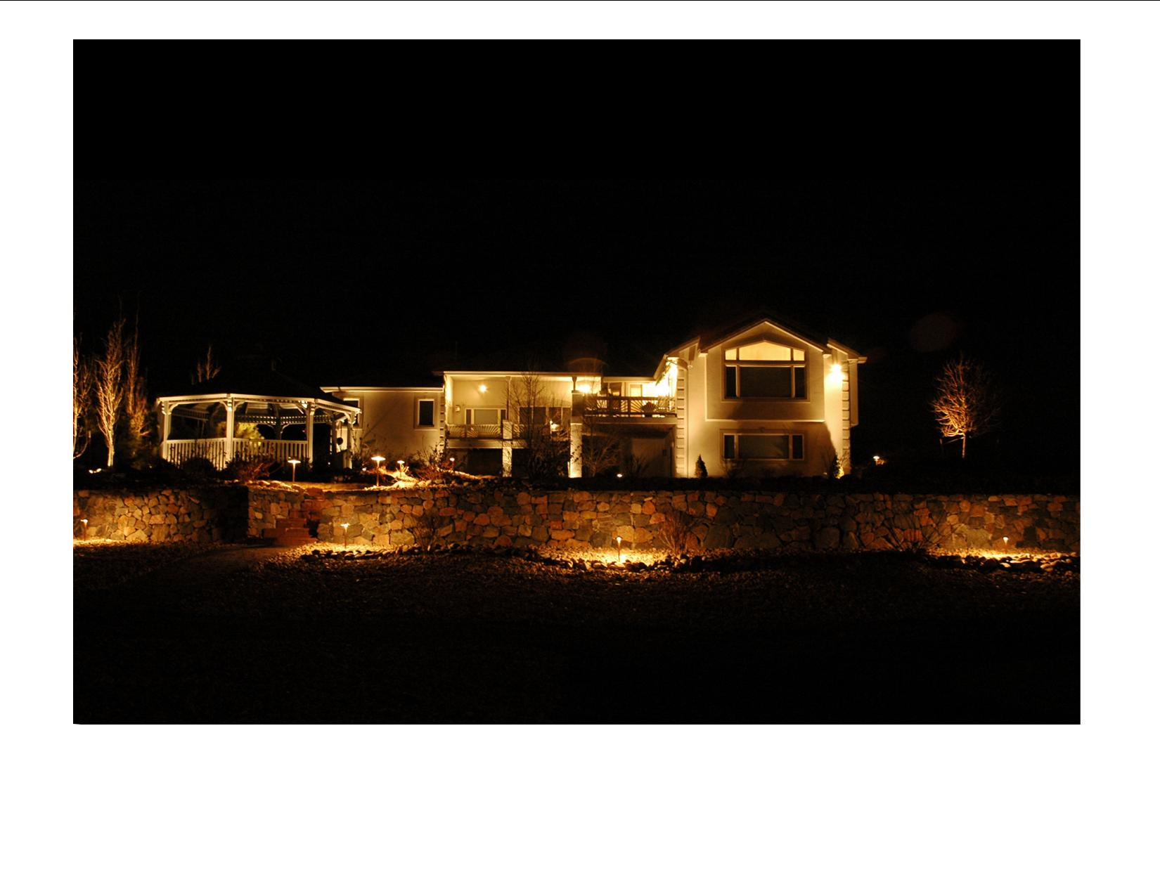 Todd Creek Farms - Brighton, CO architectural and landscape lighting. Outdoor Lighting Perspectives' designs always feature architectural lighting in conjunction with landscape lighting. By up-lighting the back of the house, the pergola and trees in conjunction with down-lighting the walkways and steps, and flood-lighting the terraced rock walls, the design is well-balanced.