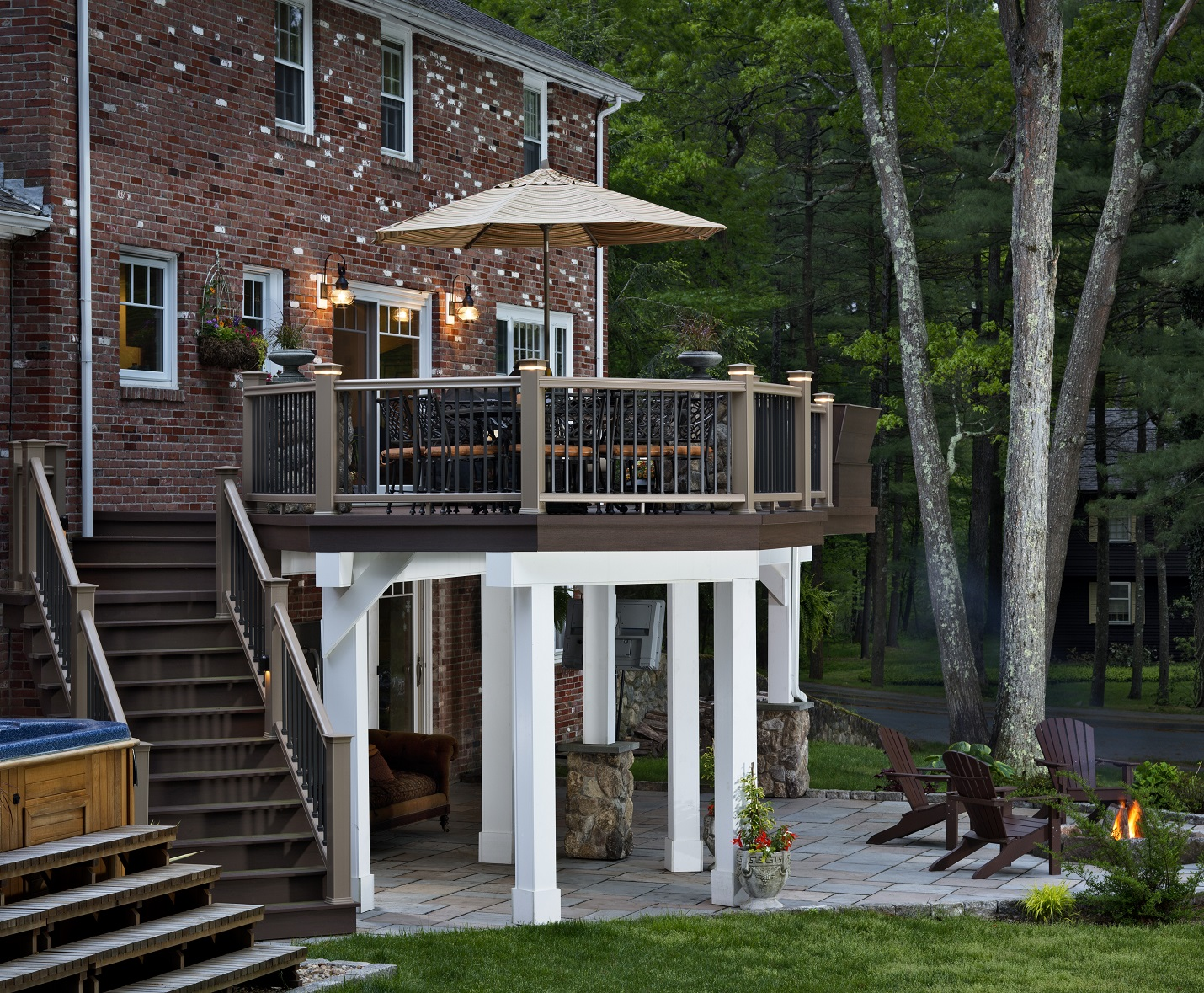 Outdoor-living-combination-design-including-an-elevated-deck-dry-deck-space-paver-patio-and-fire-pit