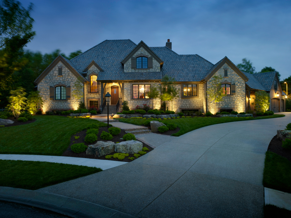Illuminating architectural textures with Cleveland outdoor lighting. When you look at this beautiful home, can you tell the finish of the home's facade?That's what well designed and installed outdoor lighting intends to do. Great architectural outdoor lighting will tell your home's facade lighting from way out in the street at night. Now that's impressive!