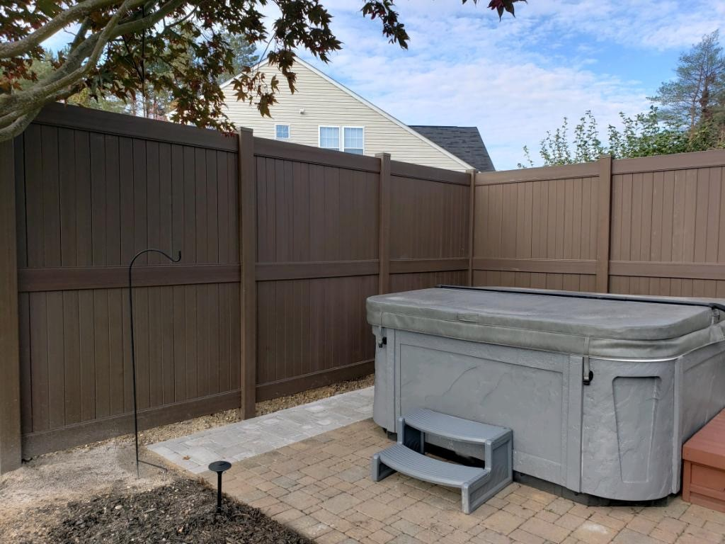 New-pavers-and-privacy-fence-for-hot-tub