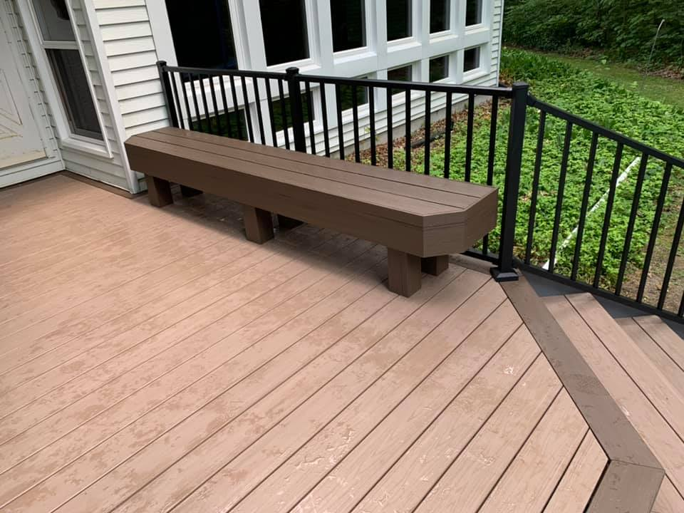 Picture-framing-design-details-and-custom-seating-make-this-deck-commmand-attention