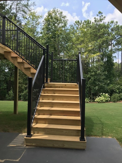 The-new-pressure-treated-decking-and-black-aluminum-railing-provide-a-stunning-contrast