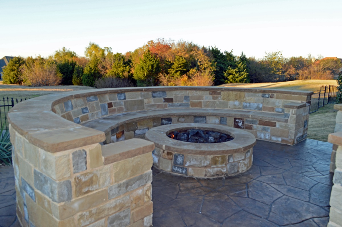 Custom-stone-fire-pit-with-seating-wall-in-Heath-TX