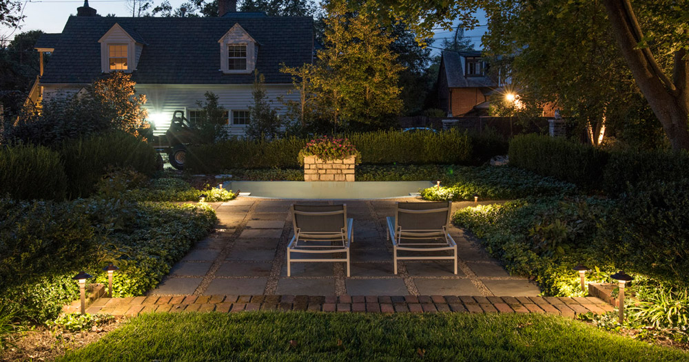 sophisticated landscape lighting brick and pavers