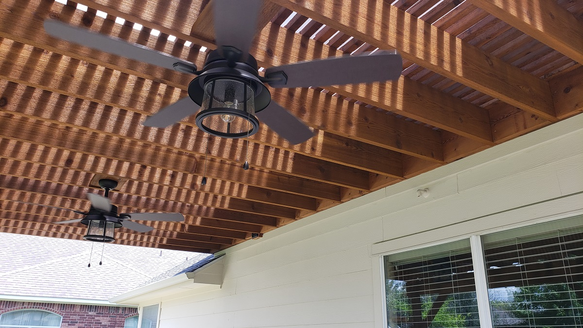 A-pair-of-ceiling-fans-top-off-the-space